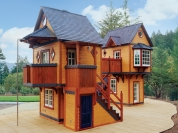 This life-size home was made to accommodate two pre-teen girls who wanted more room. The dream play structure comprises two luxury playhouses, which are fully finished inside. They feature glass doors, windows, electricity and built-in furniture. Features include French doors, a bathroom, balconies, a turbo-tube slide and fire pole. Offered at $273,900.