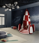 This entirely handmade armchair is inspired by two eras: both parents and kids will see inspiration from the movies Tintin and Toy Story. The body of the rocket is fiberglass, and the interior is made of red velvet upholstery. The engines of the rocket are also made from fiberglass with a new velvet flocking technique used on the inside. The staircase is made from wood and gold leaf, and features a small, secret safe. Parents will have peace of mind knowing that all of the finishes are made from non-toxic paints and varnishes. This high-tech bed features a light and sound system; both are controlled by the I-light mobile app. Through the app, you have the choice of music, light effects and sleep time. Offered at €28,610 or about $31,720. Photo courtesy Circu